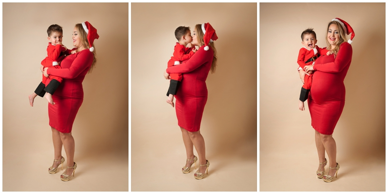 Sequence of pregnant mum in red dress and santa hat carrying her 2 year old boy